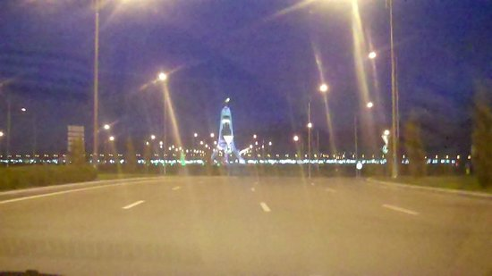 Monument Arch of Neutrality: Bitaraplyk arkasy - Arch of Neutrality Ashgabat.As seen in the distance
