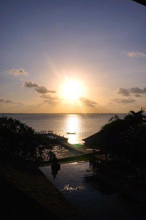 Puri Tirta Villas: sunsets from the bedroom balcony