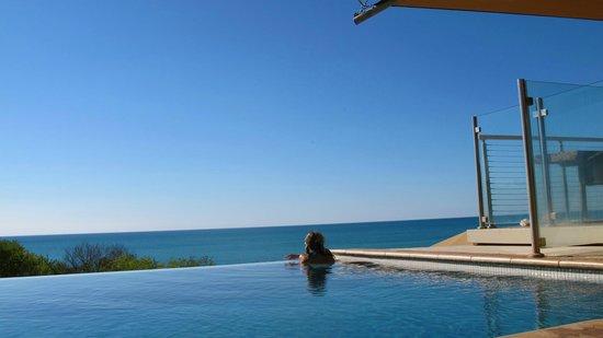 Ramada Resort by Wyndham Eco Beach: Blue blue pool and sea.