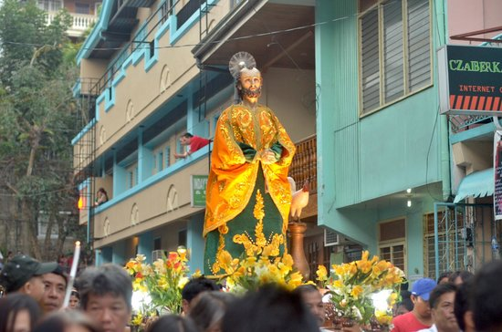 The Boac Hotel: watching Moriones Festival parade of saints (Boac Hotel as background)