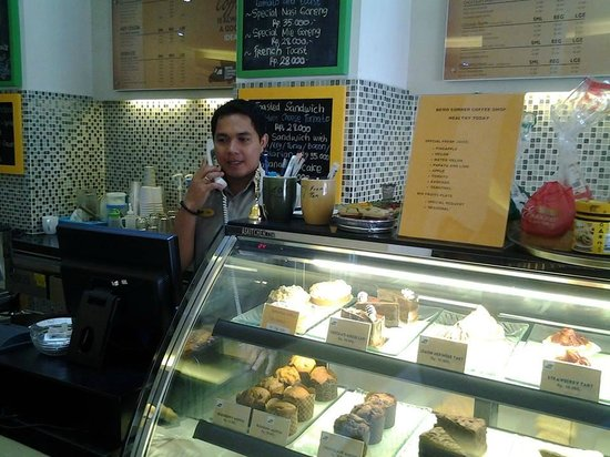Bemo Corner Coffee Shop: Adi with a selection of our cakes