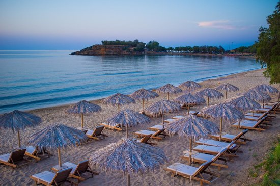 Ammos Hotel: The beach chairs, and umbrellas at sunset