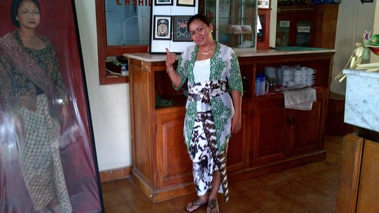 Sayang Maha Mertha: Receptionist in Traditional Balinese Dress