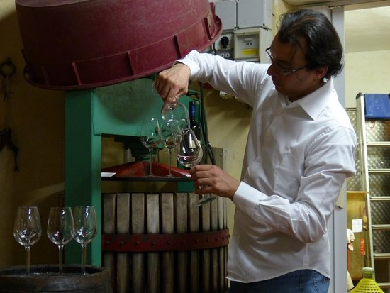 Wine Tours with Italy and Wine: our host, serving our wine