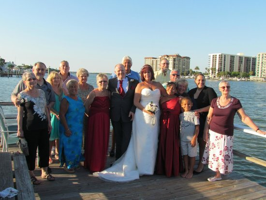 Ebb Tide Waterfront Resort : wedding guests on fishing dock