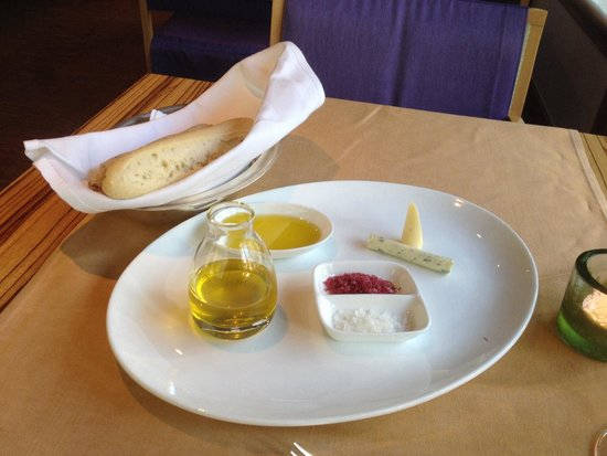 At Eight: Fresh warm bread with infused oil and salts and different types of butter