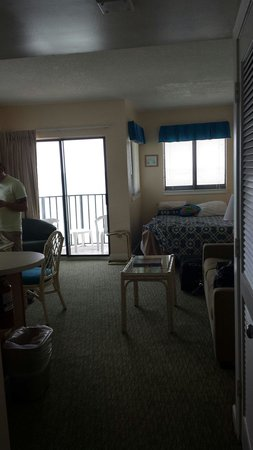 The Palace Resort : Bed and living room and balcony oceanfront sunsuite room 804