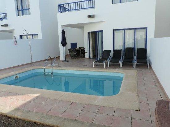 Villas Puerto Rubicon: Pool area showing master bedroom balcony