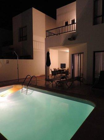 Villas Puerto Rubicon: Pool area illuminated at night showing bedroom balcony