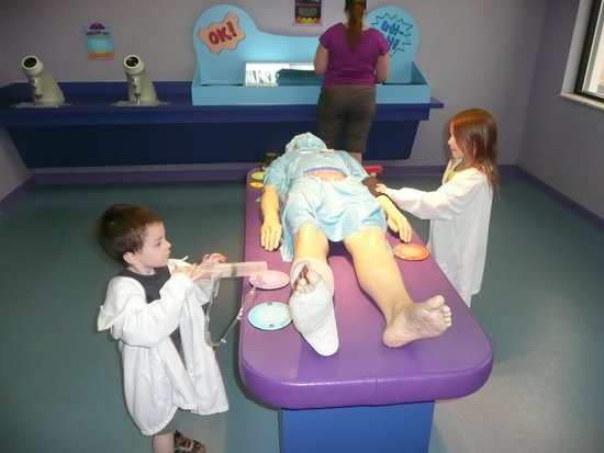 """Adventure Science Center: kids playing doctor with the life size """"body"""""""