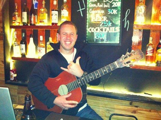 Sean love playing guitar at Hanoi Youth Hostel