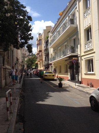AVA Hotel Athens: Street view with hotel on RHS and base of Acropolis toward the end of street