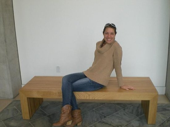Crystal Bridges Museum of American Art: Birthday at CB. Sitting one on many elegant wooden benches throughout CB. The beautiful benches
