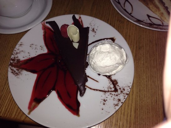 Pastiche Fine Desserts: Chocolate mouse. Whipped cream and raspberry sauce was soo good!