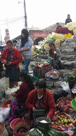 ChiChi Market: vendors on the step of the church