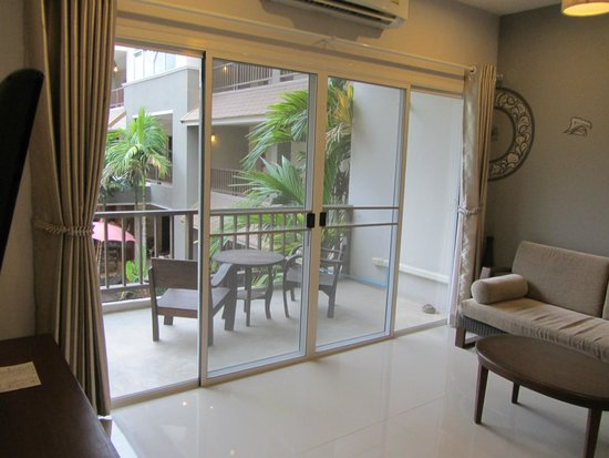 The Opium Serviced Apartment & Hotel : Living Room with Balcony