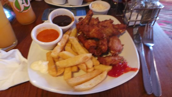 The Old Swan: chicken wednesday spicy wings and chips. LOVELY :)