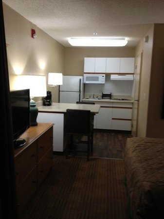 Extended Stay America - Orange County - Brea: kitchen and a multi-purpose table with electrical outlet