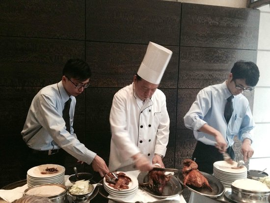 Foods of New York Tours : Peking duck wrapping.