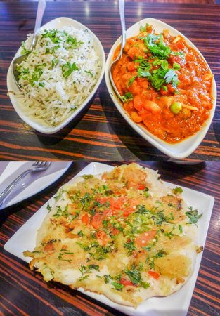 Lily's Vegetarian Indian Restaurant: On the top, jeera rice and mixed vegetable curry; below: masala uttapham.