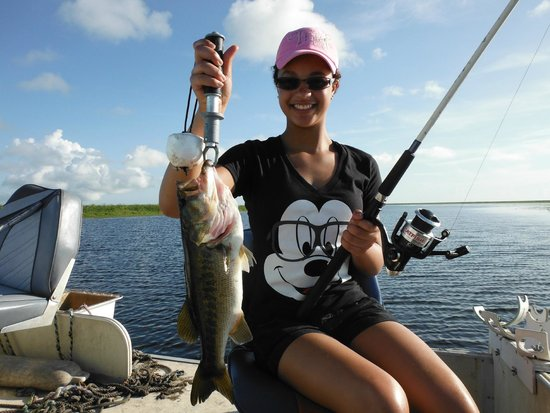 Ron's Guide Service: Happy bass fishergirl