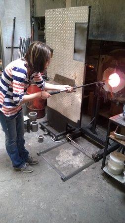 Seattle Glassblowing Studio: My wife heating her glass