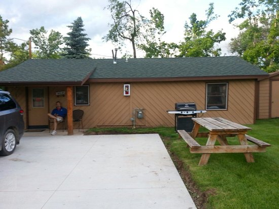 Lake Park Campground: Parking pad with gas grill and picnic table outside front door of cabin