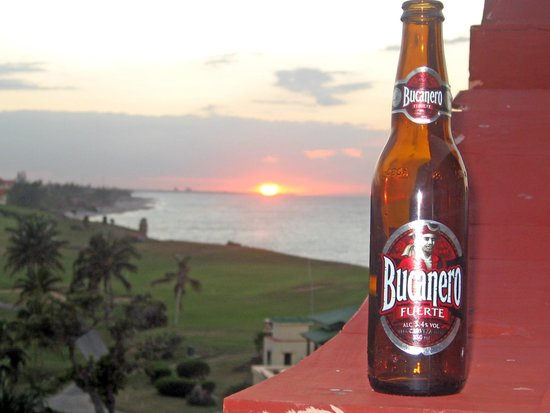 Melia Las Americas: Sunset with a bottle of chilled Bucanero