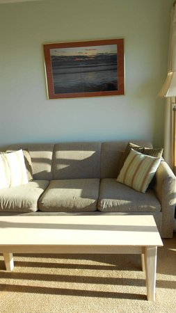 Inn at the Shore : Couch converts into bed. Sodt & long enough to sleep on as-is.