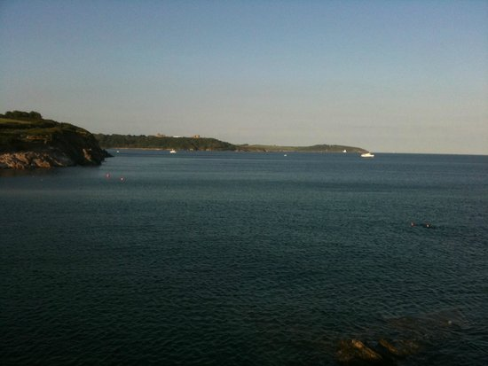 View of St Anthony's head lighthouse across the sea from Hooked on the Rocks restaurant.