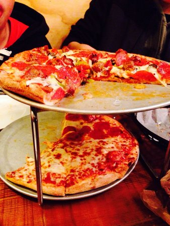 Wild West Pizzeria : Medium size. Wild West supreme pizza on top. Cheese and pepperoni on bottom.
