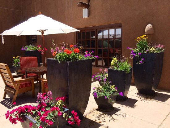 Inn and Spa at Loretto: Flower pots around pool