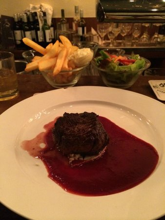 Van Kerkwijk : Filet of beef on a bed of blue cheese with strawberry sauce. Amazing!