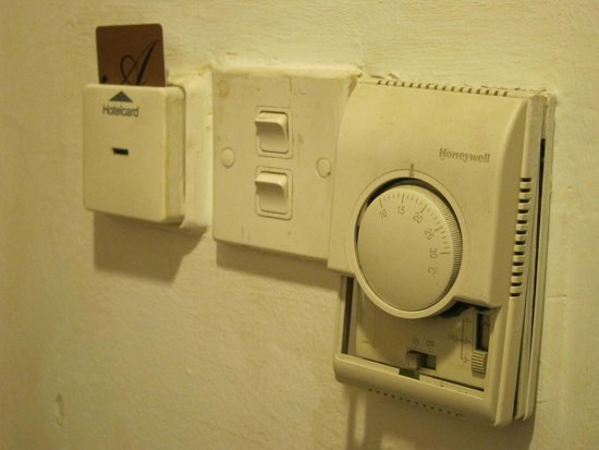 The Aston Hotel Putra Nilai: Light switches and air conditioning panel