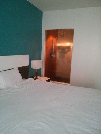 Chanalai Hillside Resort : Bed With shower in background