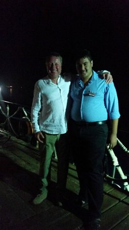 Tropitel Dahab Oasis: Dan with Esham the night time security guard on the hotel jetty
