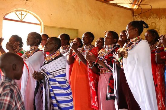 Muteleu Maasai Traditional Village: The women of the community sing and dance