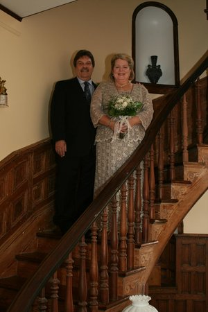 The Carriage House Inn Bed and Breakfast: Bride and groom on the gorgeous curved staircase.