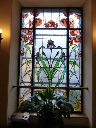 Pollera: Beautiful Art Nouveau stained glass window at head of stairs