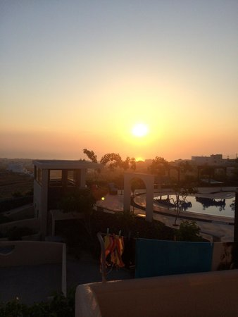 Santorini Mesotopos : Sunrise over the pool from our balcony - stunning!!