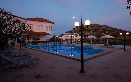 Kalithea Apartments : pool area by night