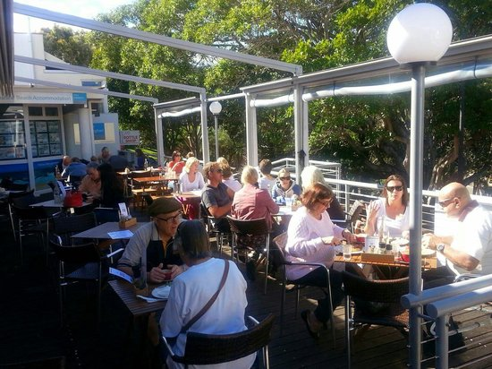 The Deck : Sunday morning crowd on a winter day. Lucky if you can find a spot in the sun