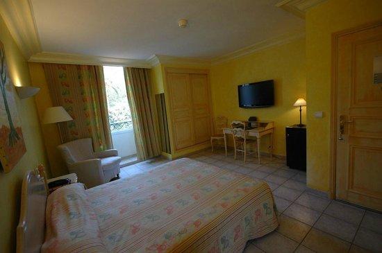 Hotel Les Palmiers: Chambre