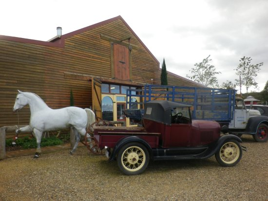 Oaklands Cafe: Exterior view of the Barn which houses most of the displays, with the outdoor plant nursery olon