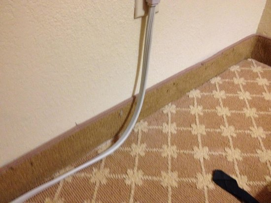 Country Inn & Suites by Radisson, Manteno, IL: staples sticking out of the carpet