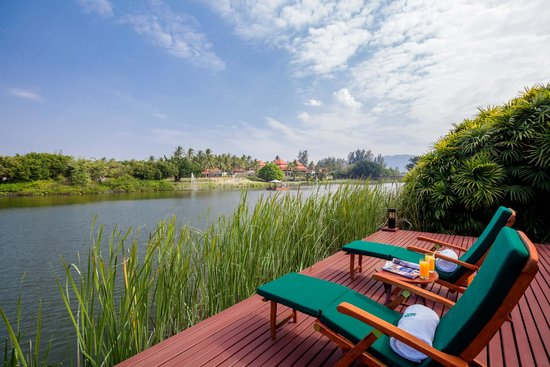 Banyan Tree Phuket: Lagoon Pool Villa sun loungers overlooking the lagoon