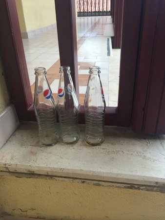 Paloma Grida Resort & Spa: Bottles left outside apartment even after I complained.
