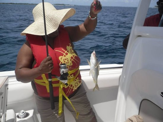 Bahama Boat Tours: I dont have the pic yet of my dad catching his fish, but here's one of my mum :)