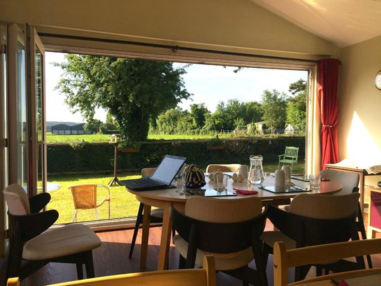Hillview: Breakfast room looking out to the garden and view.