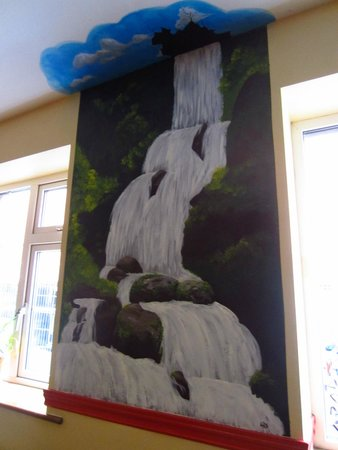 Neptunes Hostel: A painting on the walls in reception